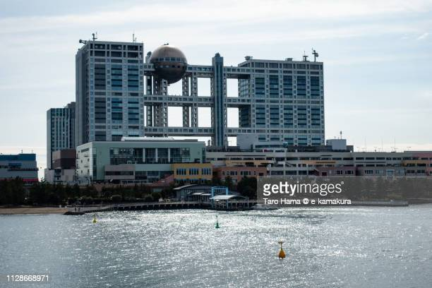 fuji television building in odaiba in tokyo in japan - fuji television stock photos and pictures