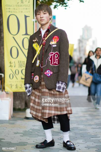 Fuji wearing a brown herringbone coat by Bonum with patches a red plaid shirt brown plaid skirt black high water pants white socks black tagged penny...