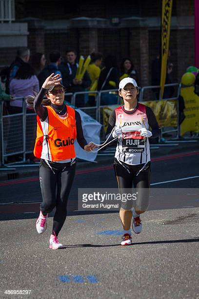 Fujii from Japan is running with her guide in the London Marathon 2014