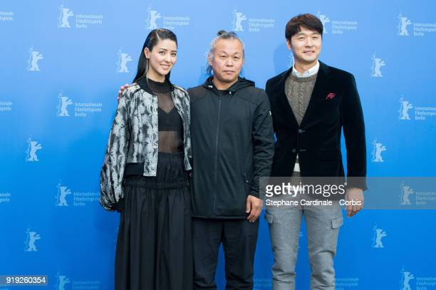 Fujii Mina Kim Kiduk and Lee Sungjae pose at the 'Human Space Time and Human' photo call during the 68th Berlinale International Film Festival Berlin...