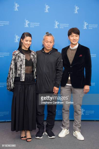 Fujii Mina, Kim Ki-duk and Lee Sung-jae pose at the 'Human, Space, Time and Human' photo call during the 68th Berlinale International Film Festival...