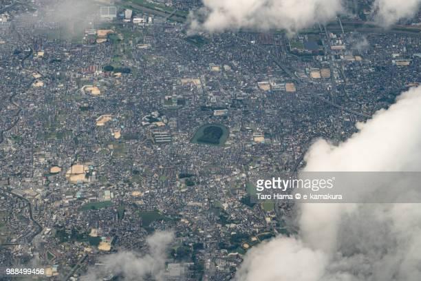 Fujiidera and Habikino cities in Osaka prefecture in Japan daytime aerial view from airplane