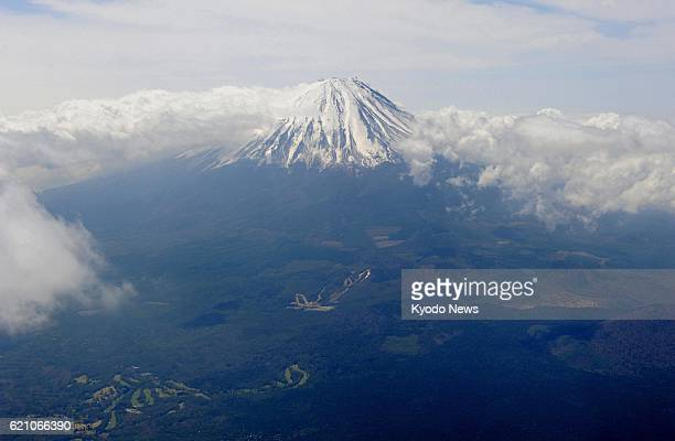 Fujikawaguchiko Japan Photo taken from a Kyodo News helicopter over the town of Fujikawaguchiko Yamanashi Prefecture on May 1 shows Mt Fuji The...