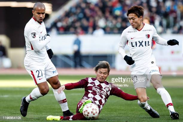 Fujimoto Noriaki of Vissel Kobe competes for the ball with Bueno of Kashima Antlers during the 99th Emperor's Cup final between Vissel Kobe and...