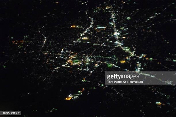 Fujinomiya city in Shizuoka prefecture in Japan night time aerial view from airplane