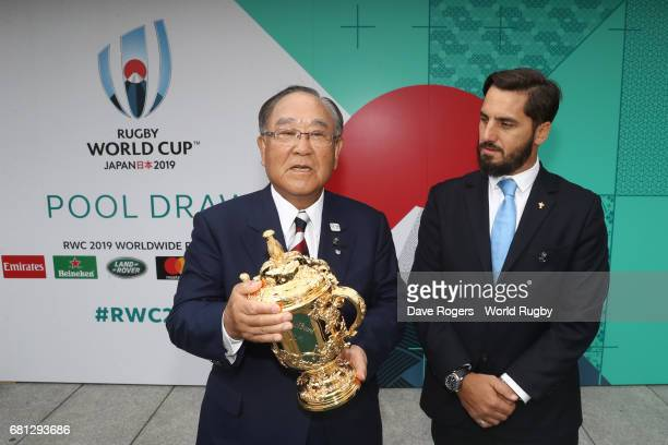 Fujio Mitarai Chairman of the RWC 2019 Organising Committee receives the William Webb Ellis cup from Agustin Pichot ViceChairman of World Rugby via...