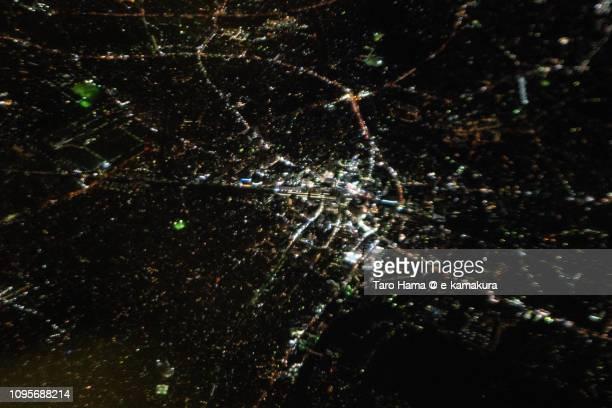 JR Fujisawa station, center of Fujisawa city in Kanagawa prefecture in Japan night time aerial view from airplane