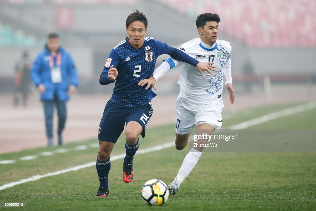 #2 Fujitani So of Japan and #17 Khamdamov Dostonbek of Uzbekistan in action during AFC U23 Championship Quarter-final between Japan and Uzbekistan at Jiangyin Sports Center on January 19, 2018 in Jiangyin, China.