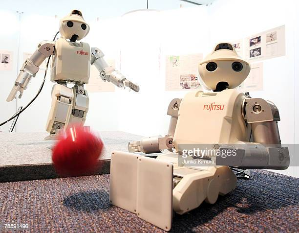 Fujitsu's humanoid robot HOAP3 kicks a ball at the Robot Award 2007 on December 20 2007 in Tokyo Japan HOAP3 is able to walk kick grasp objects and...