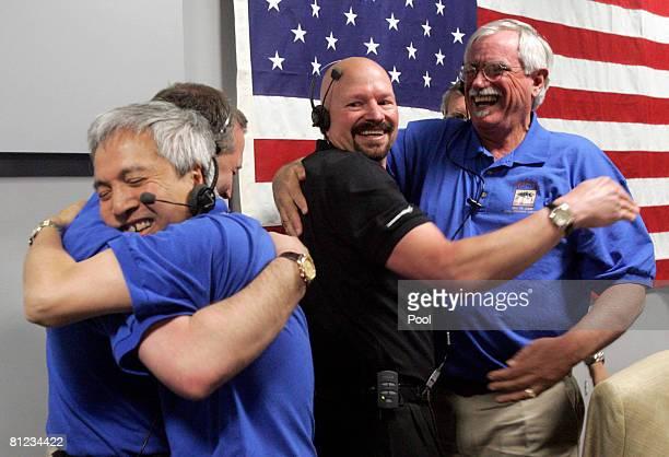 Fuk Li Manager NASA/JPL Mars Exploration Program hugs Barry Goldstein JPL Project Manager Ed Sedivy Spacecraft Manager Lockheed Martin Space System...