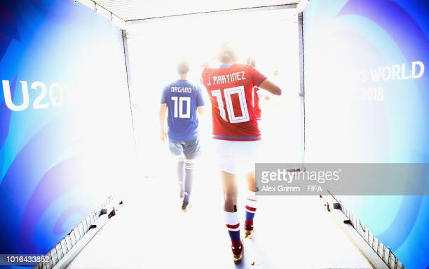 Fuka Nagano of Japan and Jessica Martinez of Paraguay are seen walking out of the tunnel prior to the FIFA U20 Women's World Cup France 2018 group C...
