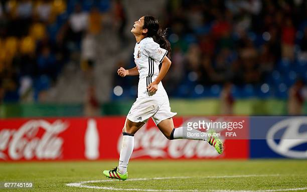 Fuka Nagano of Japan celebrates after scoring a penalty during the FIFA U17 Women's World Cup Finale match between Korea DPR and Japan at Amman...