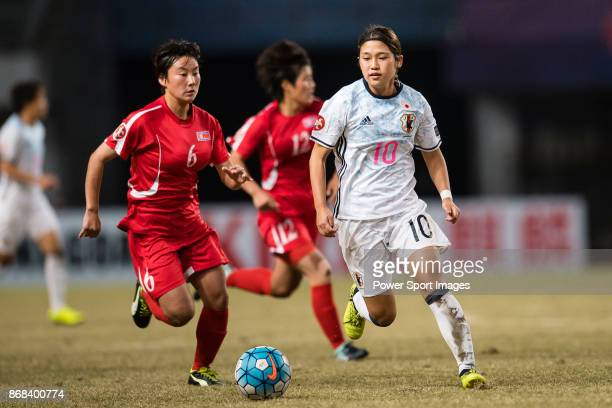Fuka Nagano of Japan in action against Ri Chun Gyong of DPR Korea during their AFC U19 Womenu2019s Championship 2017 Final match between North Korea...