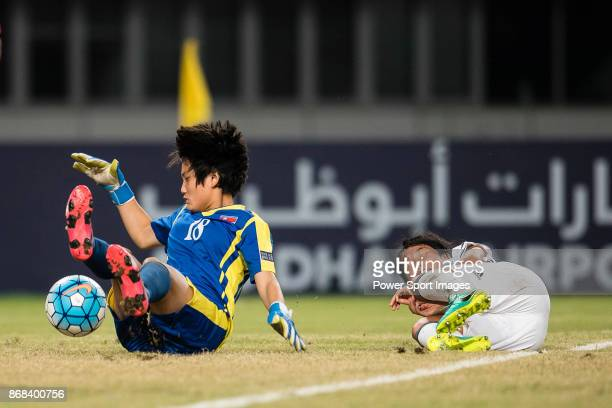 Fuka Nagano of Japan lies injured after crashed with Ri Jong Sim of DPR Korea during their AFC U19 Womenu2019s Championship 2017 Final match between...