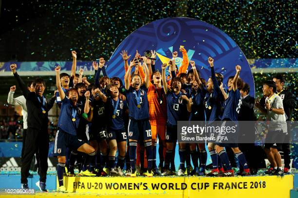 Fuka Nagano of Japan lifts the trophy as Japan celebrate victory following the FIFA U20 Women's World Cup France 2018 Final match between Spain and...