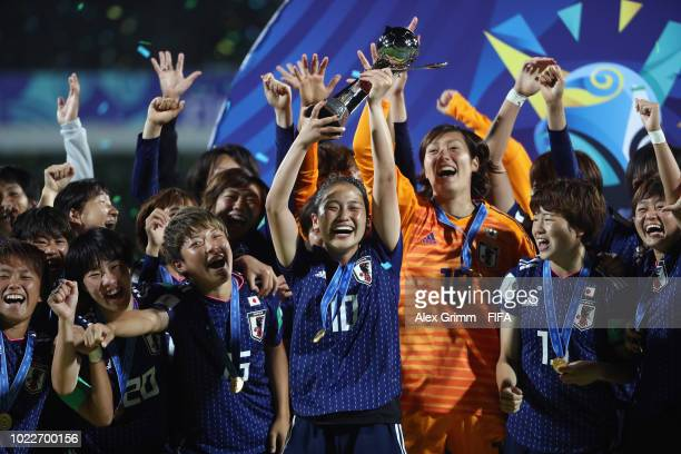 Fuka Nagano of Japan lifts the trophy with team mates after victory during the FIFA U20 Women's World Cup France 2018 Final match between Spain and...