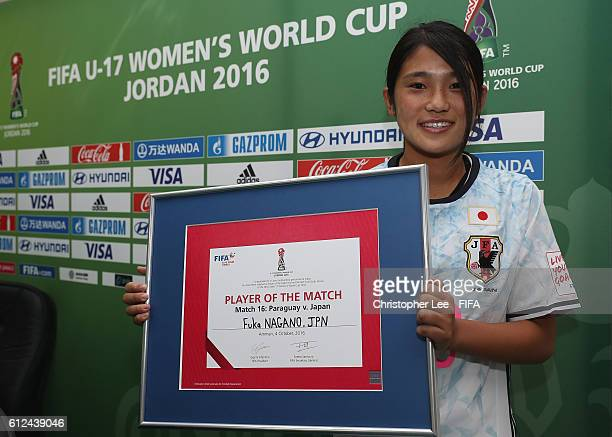 Fuka Nagano of Japan poses for the camera with her Player of the Match award during the FIFA U17 Women's World Cup Jordan 2016 Group D match between...