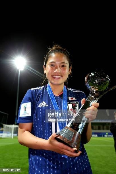 Fuka Nagano of Japan poses with the trophy following Japan winning the FIFA U20 Women's World Cup France 2018 Final match between Spain and Japan at...