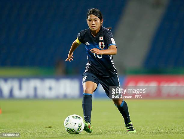 Fuka Nagano of Japan runs with the ball during the FIFA U17 Women's World Cup Group D match between Japan and USA at Amman International Stadium on...