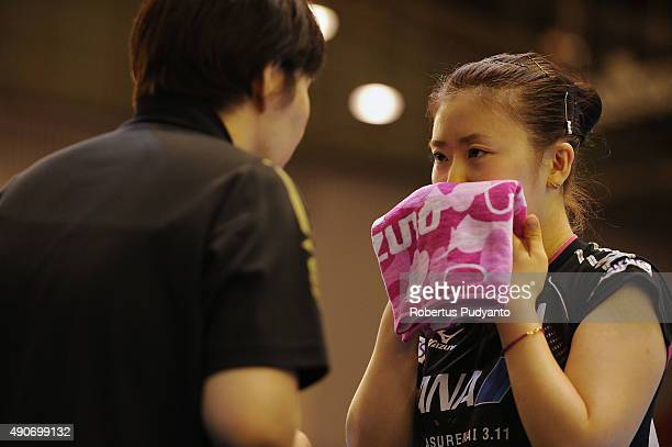 Fukuhara Ai of Japan receives instructions from her coach as she compete against Sawettabut Suthasini of Thailand during Women's singles second round...