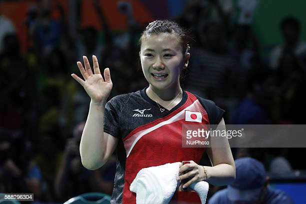 Fukuhara Ai of Japan waves to audience after the women's singles quarterfinal of table tennis between Fukuhara Ai of Japan and Feng Tianwei of...