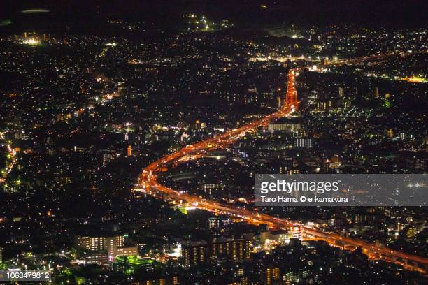 Fukuoka and Kasuga cities in Japan night time aerial view from airplane