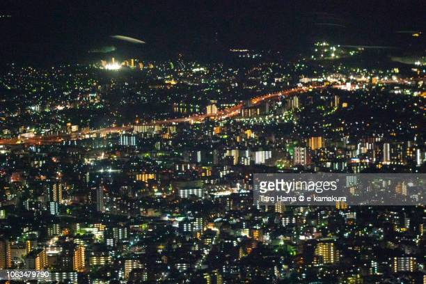 Fukuoka city in Japan night time aerial view from airplane