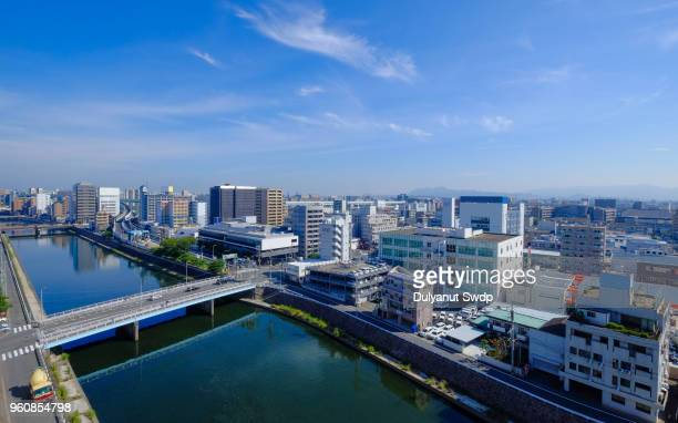 fukuoka city skyscrapers seen from high above - fukuoka city stock pictures, royalty-free photos & images