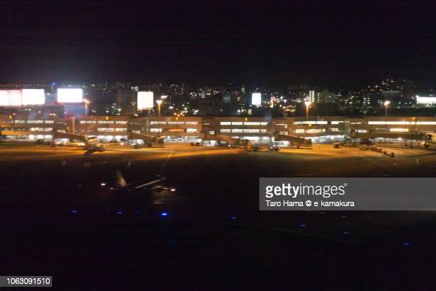 Fukuoka International Airport in Japan night time aerial view from airplane