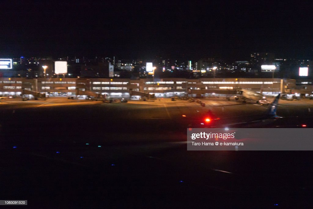 Fukuoka International Airport in Japan night time aerial view from airplane : ストックフォト