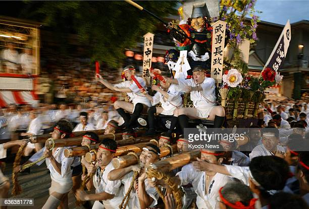 Fukuoka Japan File photo taken in July 2013 shows people carrying a float during the Hakata Gion Yamakasa Festival in Fukuoka Prefecture Japan will...
