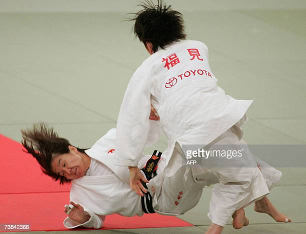TO GO WITH JUDOWORLDOLY2008JPNTANI by Shigemi Sato Ryoko Tani is thrown down by Tomoko Fukumi during their women's 48kilogram final of Japan's...