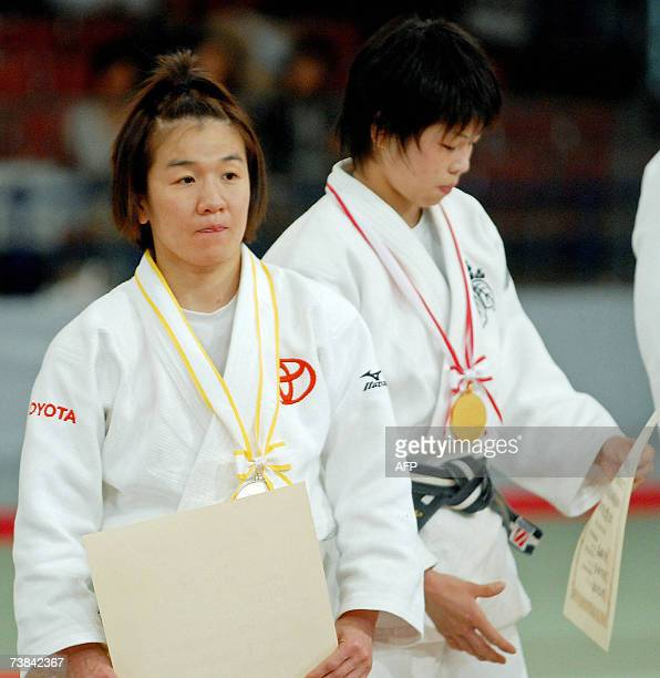TO GO WITH JUDOWORLDOLY2008JPNTANI by Shigemi Sato Ryoko Tani receives the silver medal as Tomoko Fukumi awarded gold during the awarding ceremony...