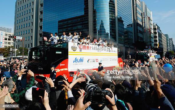 Fukuoka SoftBank Hawks players wave to fans during the victory parade on November 24 2014 in Fukuoka Japan 350000 fans gathered to celebrate their...