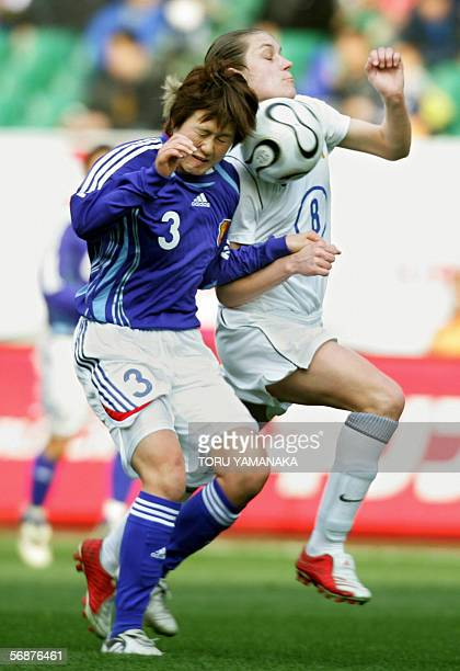 Russian forward Olesya Kurochkina battles for the ball with Japanese defender Aya Shimokozuru during their friendly match in Fukuroi central Japan 18...