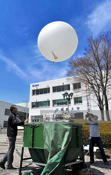 Fukushima University students release the balloon of the radiosonde to measure the radoactive substances at Fukushima University on April 15 2011 in...