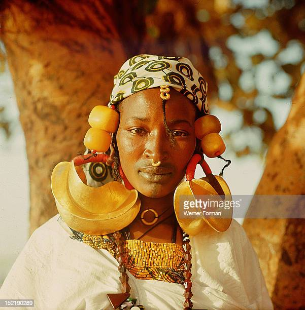 A Fulah woman photographed at Mopti She wears magnificent jewellery in the form of huge gold and amber hair decorations Mali 1962