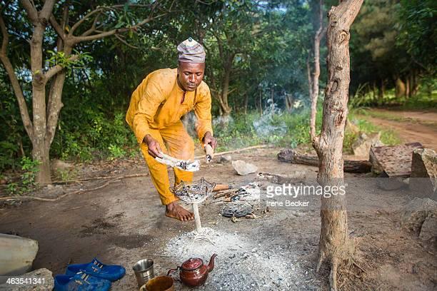 CONTENT] Fulani man preparing evening tea in the garden Kajuru Kaduna State Nigeria