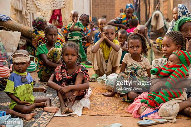 Fulani Muslim sit in a refugee camps north of Bangui on February 15 2014 in Bangui Central African Republic
