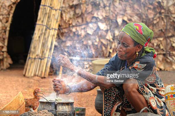 Fulani woman cooking in the morning. Marmara damishi farm in Kaduna State