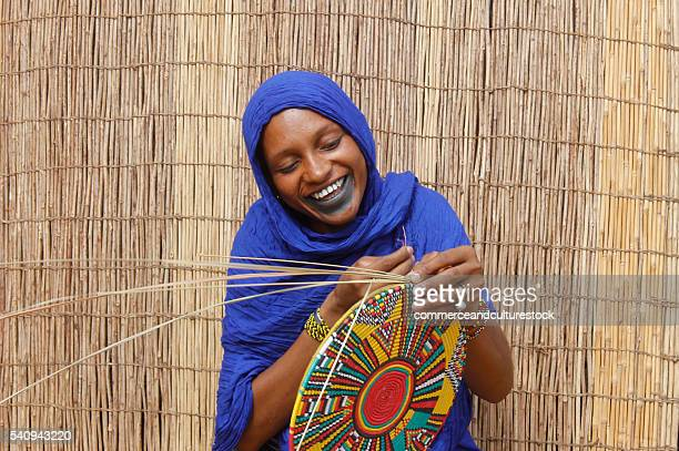 a fulani woman firing a van - fulani stock photos and pictures