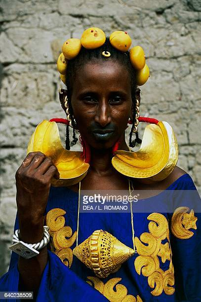 Fulani woman from a wealthy Marabout family wearing clothes and jewelry for a wedding village near Mopti Mali