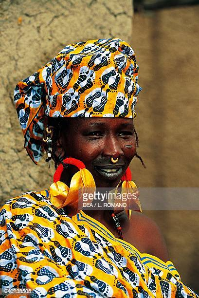 Fulani woman in traditional clothes with large earrings in a village near Djenne Mali