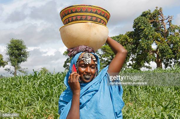 fulani woman with a mobile phone - fulani stock photos and pictures