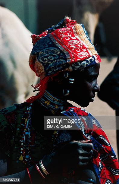 Fulani woman with colourful head covering and jewels Niger