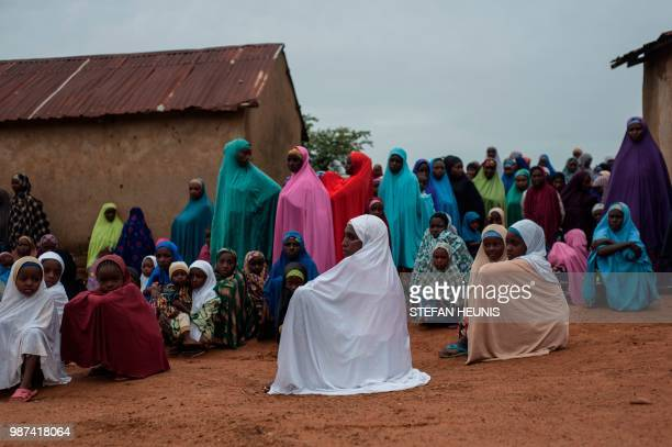 Fulani women sit together in the Fulani village of Luggere in the Barkin Ladi area in Plateau State on June 29 2018 Plateau State in Nigeria has seen...