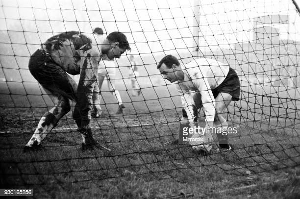 Fulham 101 Ipswich Town league match at Craven Cottage Boxing Day Thursday 26th December 1963 'Allow me' Graham Leggat picks up the ball for tired...