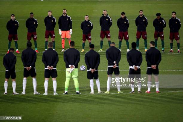 Fulham and Wolverhampton Wanderers players observe a two minute's silence in memory of the Duke of Edinburgh, following the announcement of his death...
