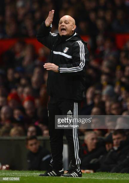 Fulham Assistant Head Coach Ray Wilkins gestures during the Barclays Premier League match between Manchester United and Fulham at Old Trafford on...