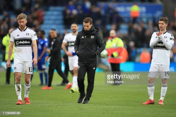 Fulham Caretaker Manager Scott Parker among his players after the defeat during the Premier League match between Leicester City and Fulham FC at The...